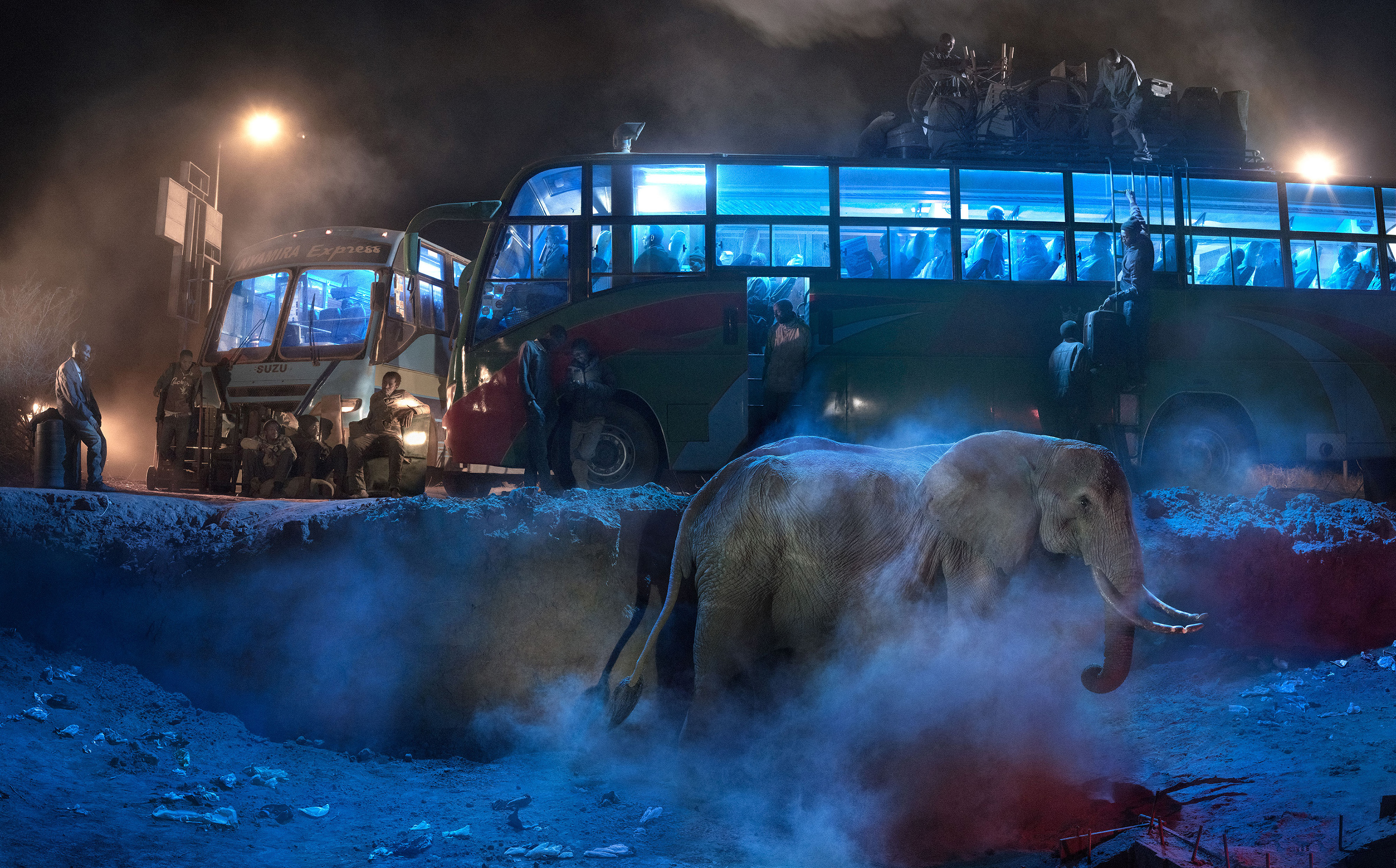 BUS STATION WITH ELEPHANT IN DUST