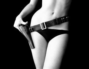 Kate-Gun-Belt-front-one-hand-Sam-Haskins-1964