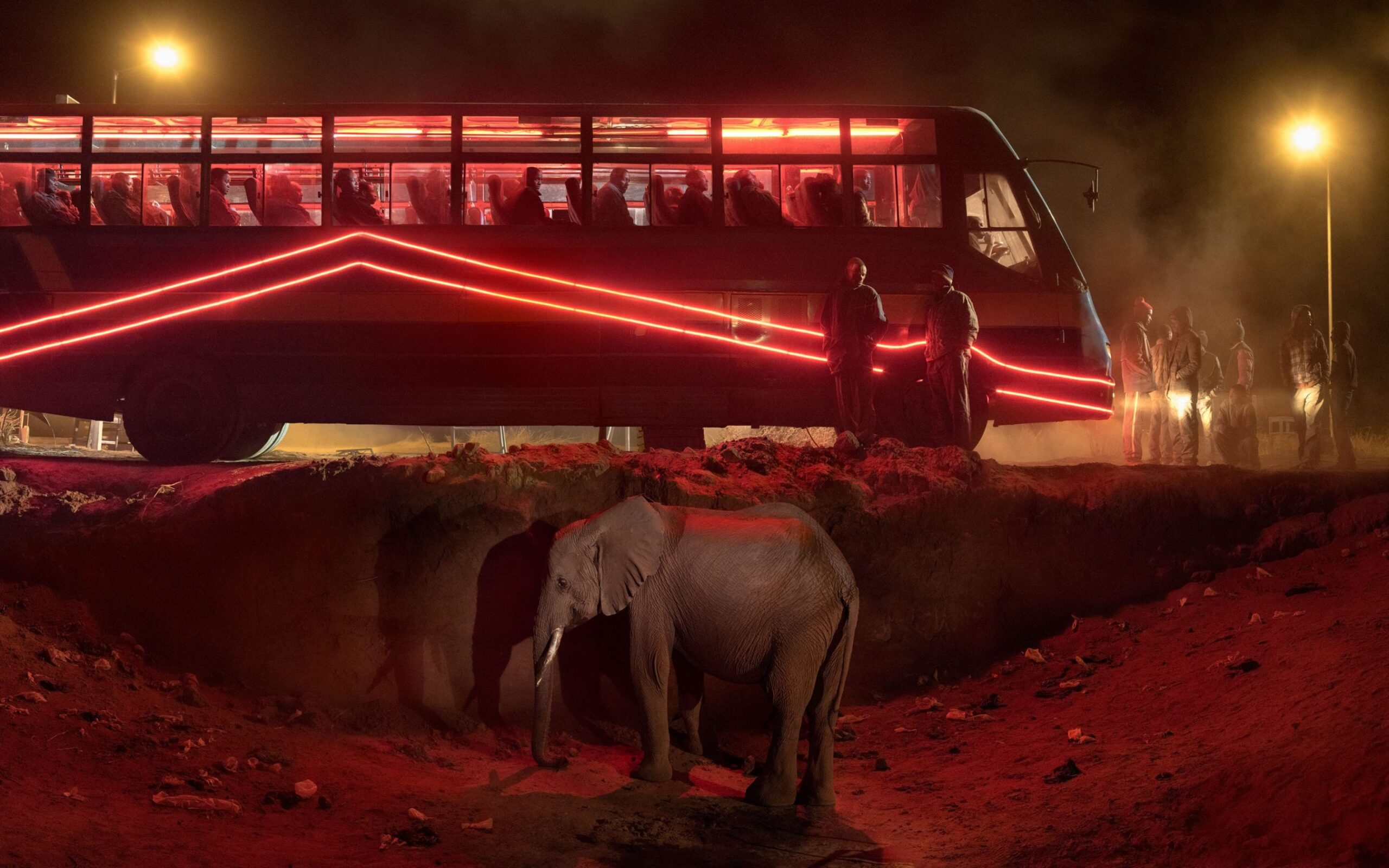 Nick Brandt BUS-STATION-WITH-ELEPHANT-&-RED-BUS